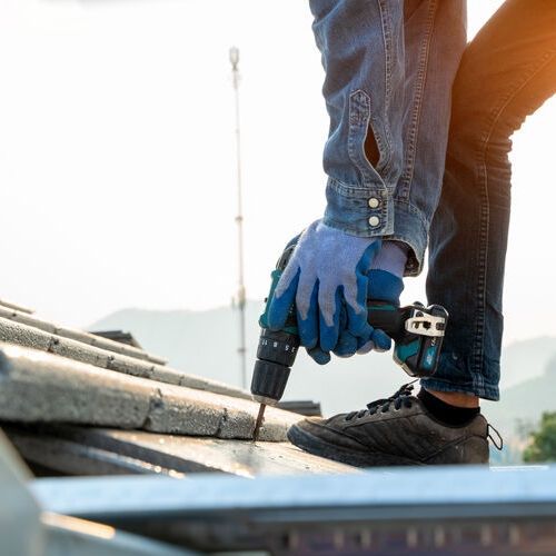 contract roofer working on commercial roof