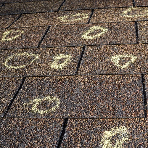Insurance adjuster use chalk to mark roof damage. Need help with your roof damage claim? We can help.